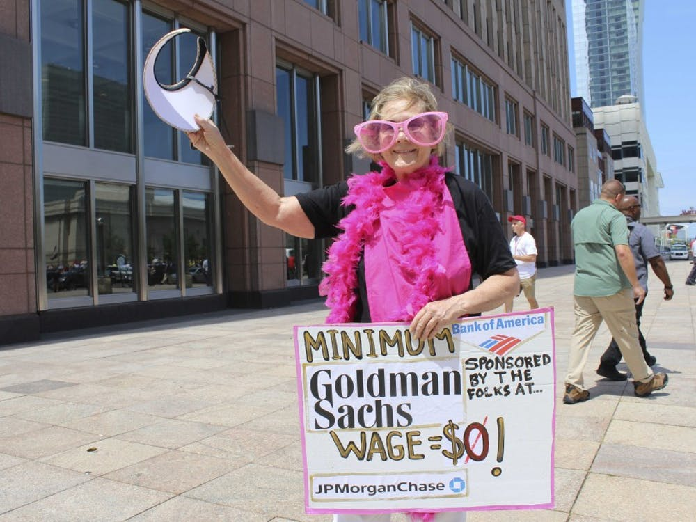 """Ann Wright, 70, is protesting with Code Pink: Women for Peace and Veterans for Peace in Cleveland. Wright, however, says she is with """"Billionaires for Trump,"""" and aims to send a satirical message referencing big banks and corporate America's role in political campaigns."""