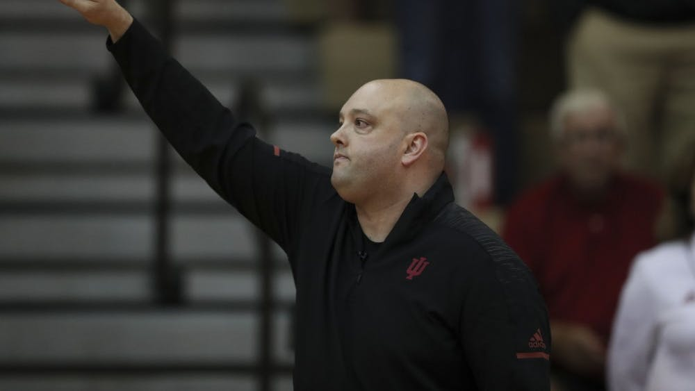 IU volleyball Head Coach Steve Aird instructs the team Sept. 21, 2018, at the game against Northwestern University at University Gym. With year two of his coaching tenure about to begin, Aird said he is happy with the direction his program is headed.