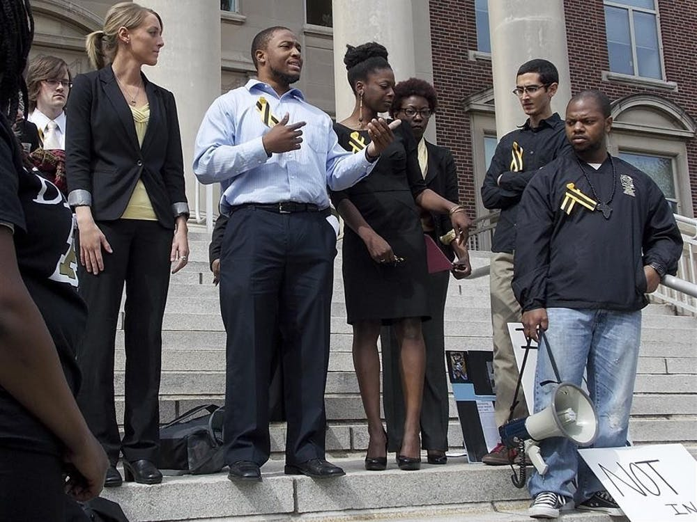 Tyrell Conner, a leader of the Purdue Anti-Racism Coalition, shares the group's plans with the crowd gathered Friday in front of Hovde Hall at Purdue University.