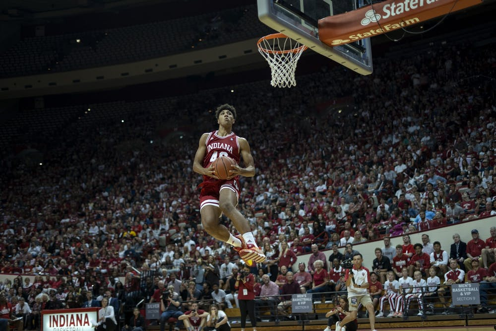 <p>Then-freshman, now-junior forward Trayce Jackson-Davis goes up for a celebratory dunk after winning the dunking contest at Hoosier Hysteria on Oct. 5, 2019, in Simon Skjodt Assembly Hall. Hoosier Hysteria will take place Oct. 2 this year.</p>
