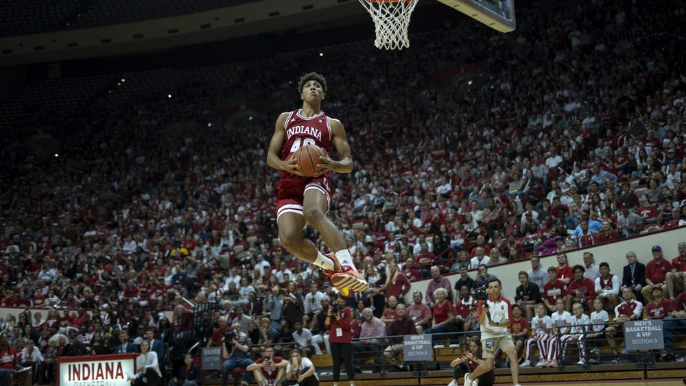 Then-freshman, now-junior forward Trayce Jackson-Davis goes up for a celebratory dunk after winning the dunking contest at Hoosier Hysteria on Oct. 5, 2019, in Simon Skjodt Assembly Hall. Hoosier Hysteria will take place Oct. 2 this year.