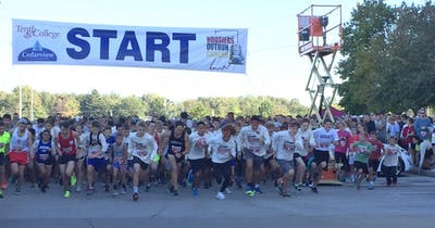 Runners take off at the start of Hoosiers Outrun Cancer fundraising race.