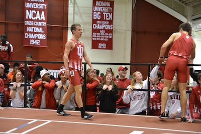 Kyle Mau and Daniel Michalski celebrate with teammates after the men's distance medley Jan. 25 at the IU Relays at Gladstein Fieldhouse. Mau now holds the NCAA's fastest time this season in the men's mile.