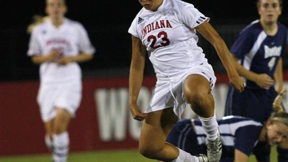Junior Liz Holby plays the ball during a game verses Butler on Thursday night at Bill Armstrong Stadium. IU lost 2-1.