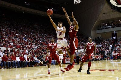 Freshman guard Rob Phinisee scores the ball against University of Arkansas on March 23 at Simon Skjodt Assembly Hall. IU won in the second round of the NIT against Arkansas, 63-60.