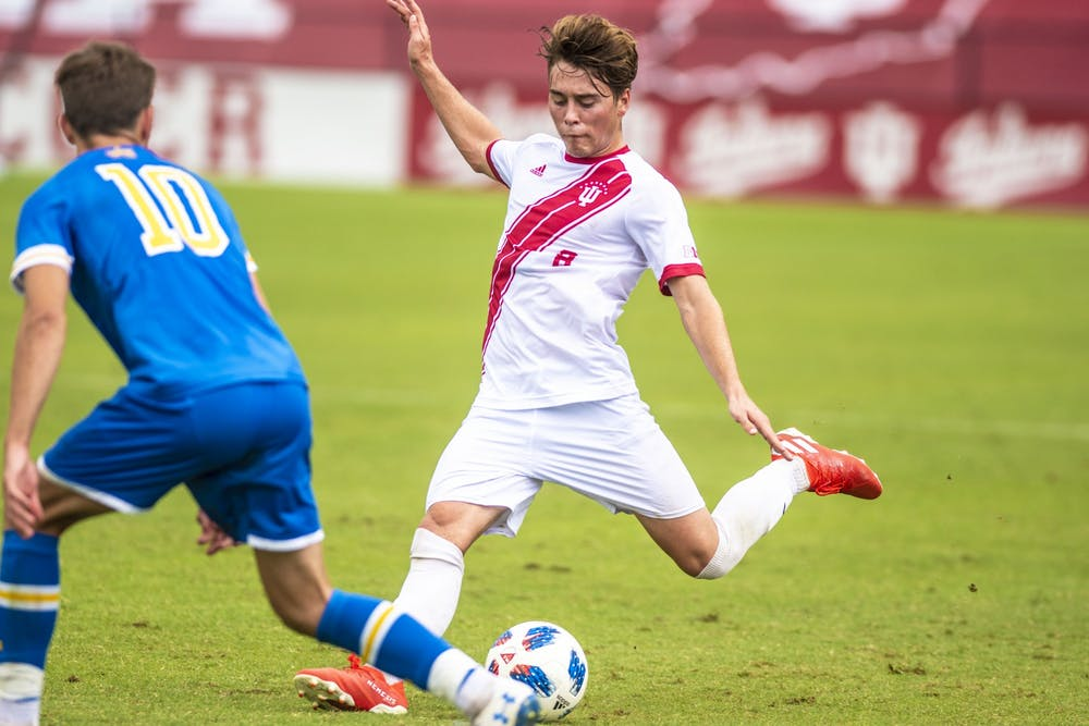 <p>Freshman Aidan Morris plays a long ball during IU's 2-1 win over University of California, Los Angeles on Sep. 2 at Bill Armstrong Stadium. It was announced Jan. 14 that Morris signed a Homegrown Player contract with Columbus Crew.</p>