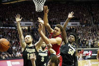 Redshirt-sophomore forward Race Thompson goes up for a shot while being quadruple teamed by Purdue senior forward Evan Boudreaux, senior guard Jahaad Proctor, sophomore forward Trevion Williams and sophomore guard Sasha Stefanovic. Thompson scored six points and earned eight rebounds against Purdue at Mackey Arena in West Lafayette, Indiana.