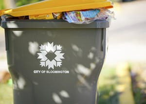 City of Bloomington trash and recycling bins sit behind Phi Gamma Delta fraternity Monday morning near Woodlawn Avenue. This is one of three available sizes provided by Bloomington for a monthly fee.