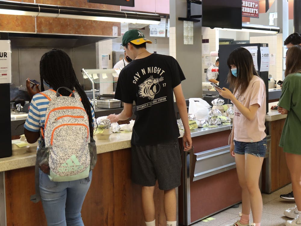 Students look for their food orders Aug. 29, 2021, in Wright Quad food court. GrubHub is a service that IU Dining uses for students to order food on campus in some locations.