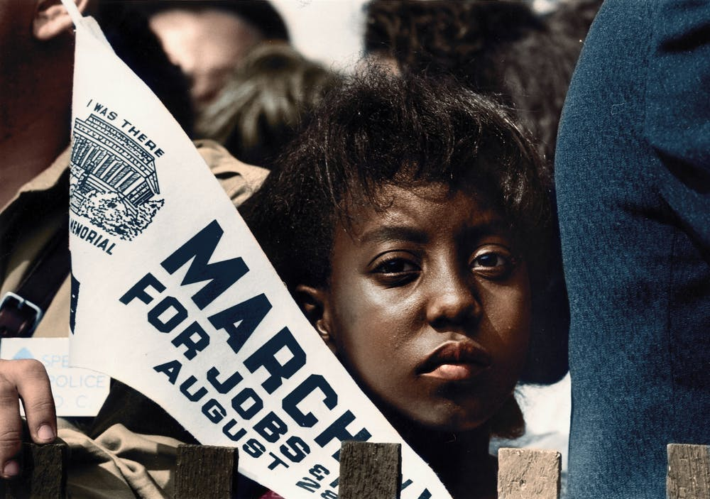 <p>A girl holds a banner Aug. 28, 1963, at the Civil Rights March on Washington, D.C.</p>