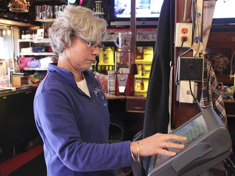 Nick's English Hut co-owner Susan Bright works a register Tuesday at the restaurant. The restaurant is at the center of a $1.2 million credit card scam.