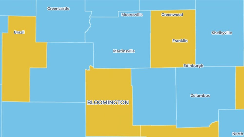 The Indiana Daily Student COVID-19 map shows Bloomington in yellow. Monroe County's COVID-19 Advisory Level changed from blue to yellow this week, indicating increased cases per 100,000 residents and a higher positivity rate.
