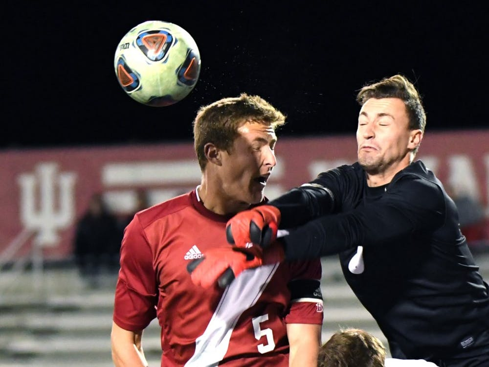 Senior defender Grant Lillard goes to head the ball against New Hampshire in the third round of the NCAA tournament at Bill Armstrong Stadium. IU defeated New Hampshire, 2-1, to advance to the quarterfinals of the NCAA tournament against Michigan State.