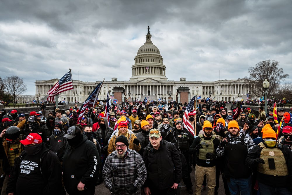 <p>A mob of supporters of outgoing president Donald Trump congregate outside of the U.S. Capitol Building on Jan. 6 in Washington, D.C. </p>