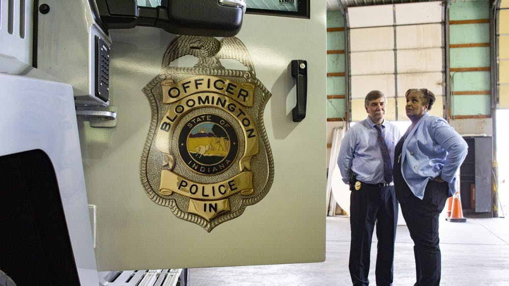 Bloomington Police Department Chief Mike Diekhoff speaks with an attendee at the official unveiling of BPD's new armored vehicle July 10, 2018, in the Switchyard Park Operations building. There has been a 4.7% decrease in crime from 2018 to 2019, but there was an increase in violent crimes in Bloomington.