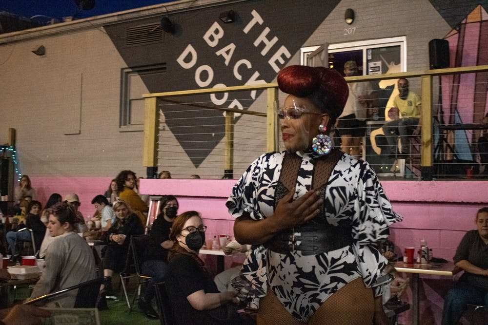 <p>Mocha Debeauté performs Saturday night at The Back Door in Bloomington. The Back Door, an LGBTQ inclusive nightclub, reopened Saturday night after temporarily closing due to the COVID-19 pandemic.</p>