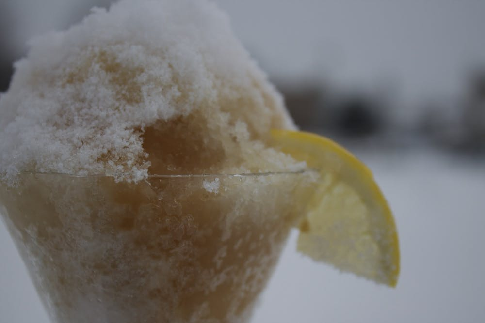 <p>A pared-down amaretto sour, consisting of just the almond-flavored liqueur, and fresh lemon juice over snow is pictured. </p>