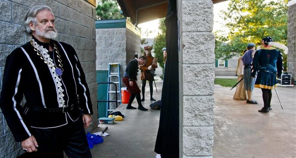 """Retired IU Professor Jeffrey Huntsman waits for his line during rehearsals Wednesday evening at the Third Street Park stage. Huntsman is performing in the Monroe County Civic Theater's performance of """"Two Gentlemen of Verona"""" which will be showing on Sept. 12"""