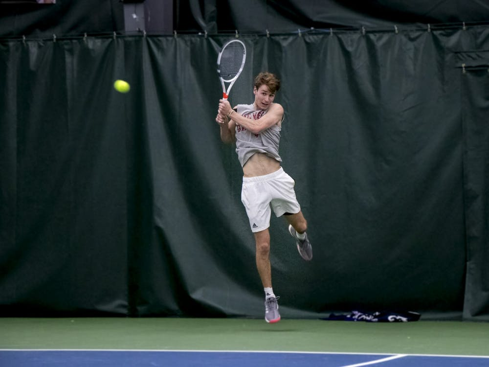 IU senior Bennett Crane leaps for the ball in a match against the University of Memphis on Jan. 17 at the IU Tennis Center. Crane is the highest ranked Hoosier since Sam Monette in 2016, who opened the season at No. 27.