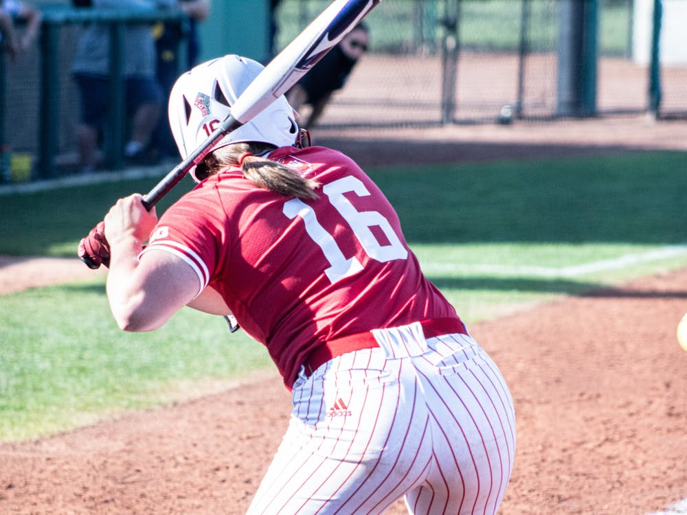 Graduate student infielder Micah Schroder watches as the pitch comes in Saturday at Andy Mohr Field. The IU softball team was swept in its four-game series against Michigan this weekend.