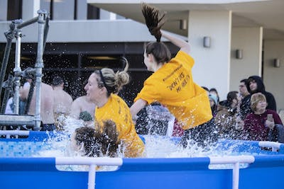 People jumpeed Feb. 16 into a pool of water in the Polar Plunge. The event raises money in support of Indiana's Special Olympics.