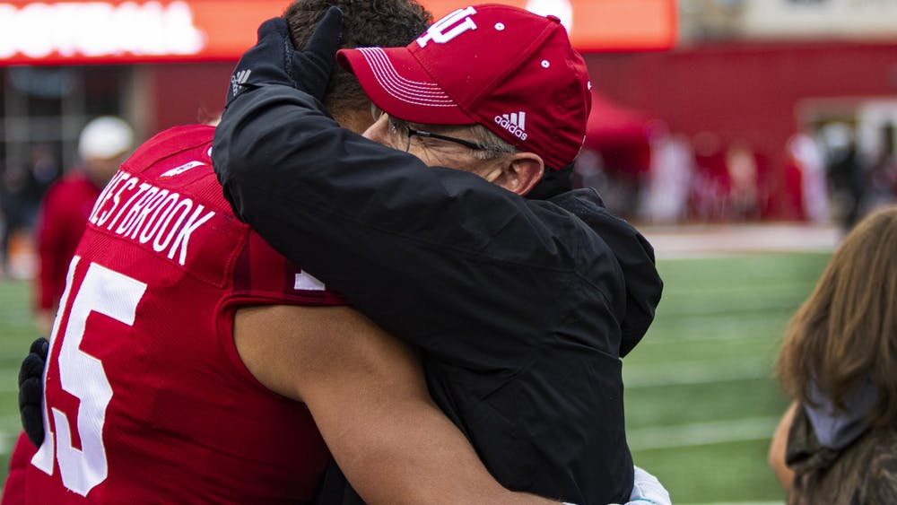 Football head coach Tom Allen hugs fifth-year wide receiver Nick Westbrook during senior night Nov. 23 in Memorial Stadium. IU seniors were acknowledged before the game against Michigan.