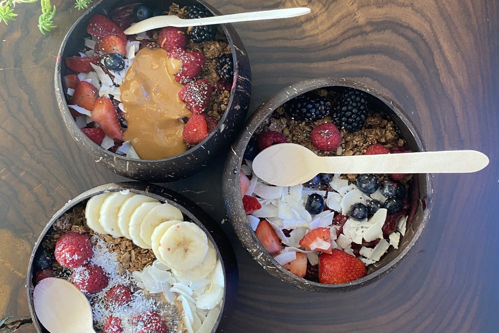 Smoothie bowls from Soul Juice sit on a table.