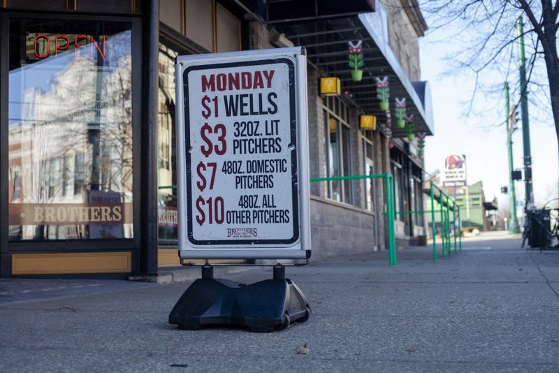 A sign sits outside Feb. 25 at Brothers Bar and Grill. Brothers, among other bars, has daily deals and specials people can take advantage of.