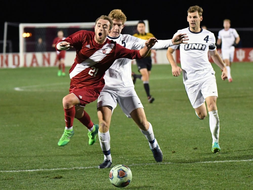 Redshirt freshman defender Spencer Glass is fouled by New Hampshire in the third round of the NCAA tournament Saturday evening at Bill Armstrong Stadium. Junior midfielder Francesco Moore made a penalty kick after the foul to score IU's second goal in their 2-1 win against New Hampshire.