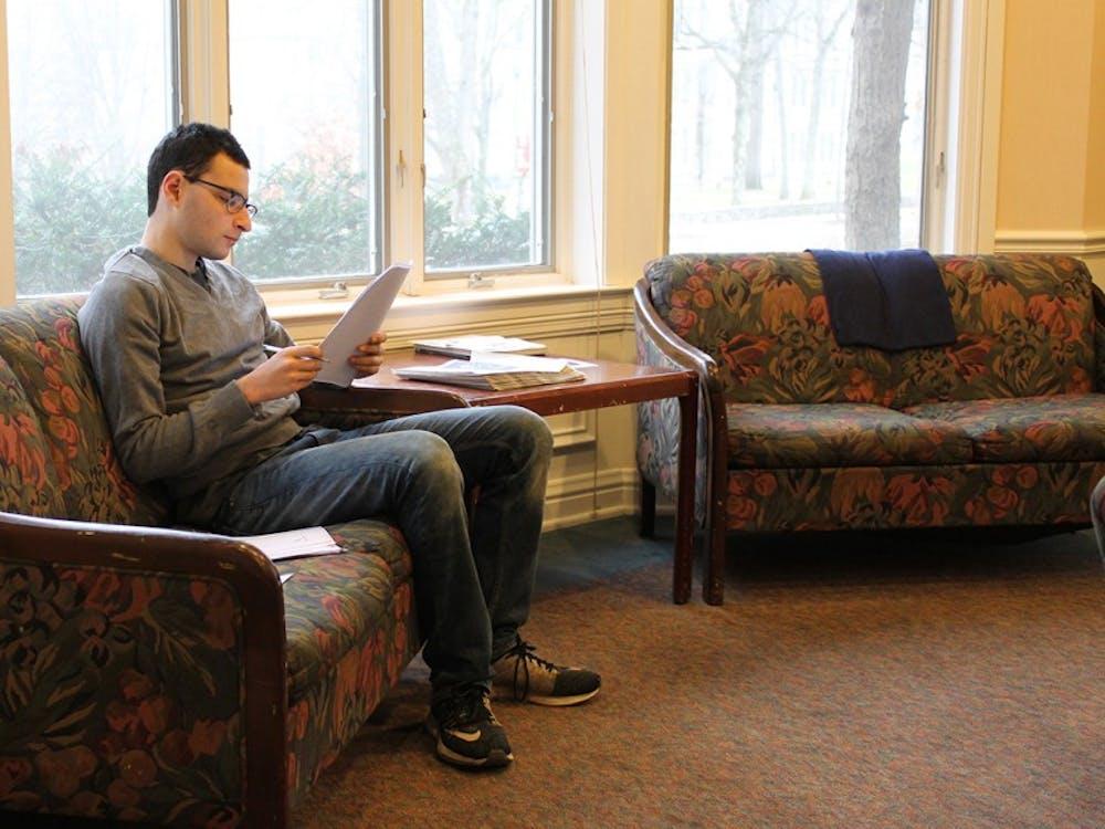 Freshman Abe Shapiro does homework in the Helene G. SimonHillel Center between classes.