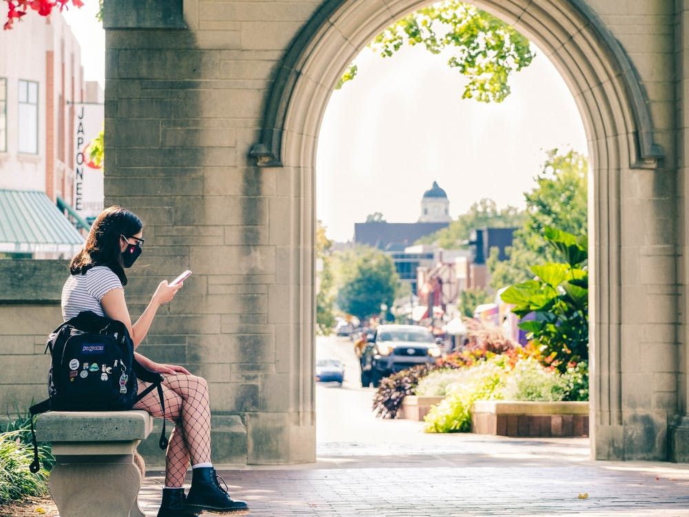 Freshman Brooklynn Zabel looks at her phone while waiting for her friend Aug. 24 at the Sample Gates.
