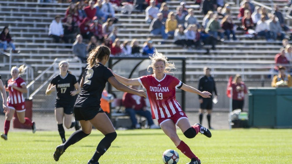 Senior Chandra Davidson tries to move the ball across the field Oct. 27 at Bill Armstrong Stadium. IU lost its last home game of the regular season to Purdue, 1-2.
