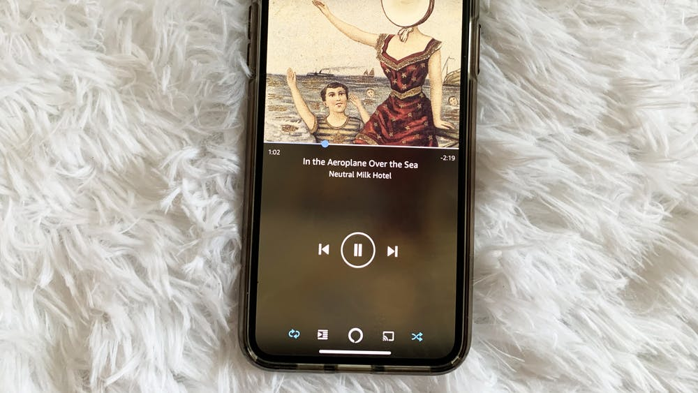 """An iPhone is pictured showing the song """"In the Aeroplane Over the Sea"""" by Neutral Milk Hotel."""