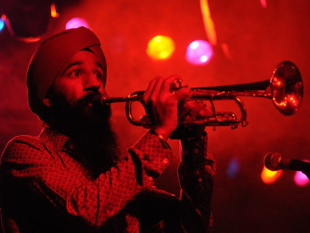 Sonny Singh, of the band Red Baraat, plays the trumpet during the band's Lotus Fest performance in 2010 in the Lifecycle Tent.