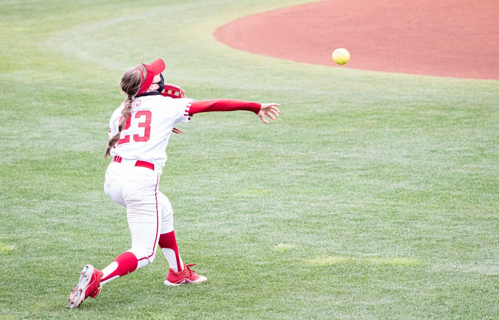 <p>Senior outfielder Gabbi Jenkins throws the ball against Michigan on March 28 at Andy Mohr Field. The Hoosiers will play a four -game series against Purdue this weekend in West Lafayette, Indiana. </p>