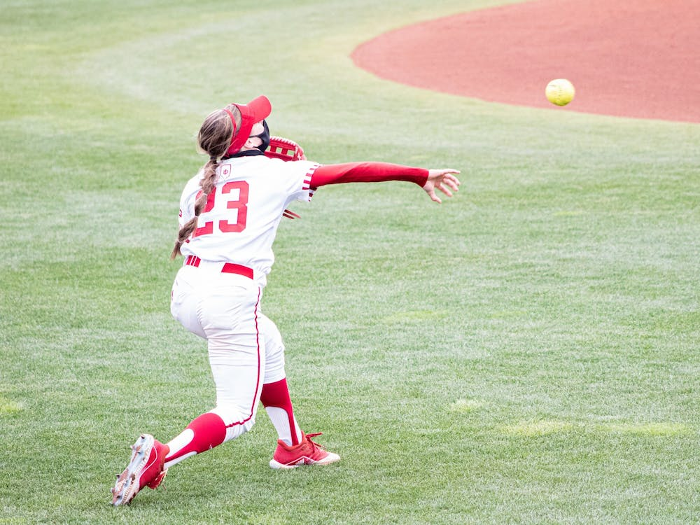 Senior outfielder Gabbi Jenkins throws the ball against Michigan on March 28 at Andy Mohr Field. The Hoosiers will play a four -game series against Purdue this weekend in West Lafayette, Indiana.