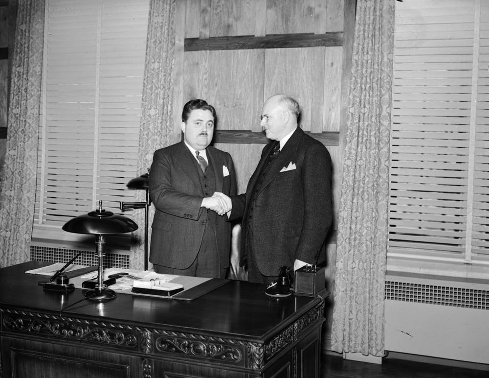 <p>Former IU President Herman B Wells shakes Ora L. Wildermuth's hand in 1938.</p>