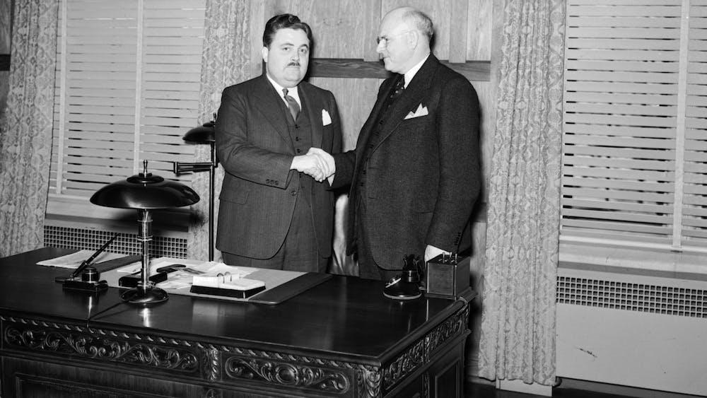 Former IU President Herman B Wells shakes Ora L. Wildermuth's hand in 1938.