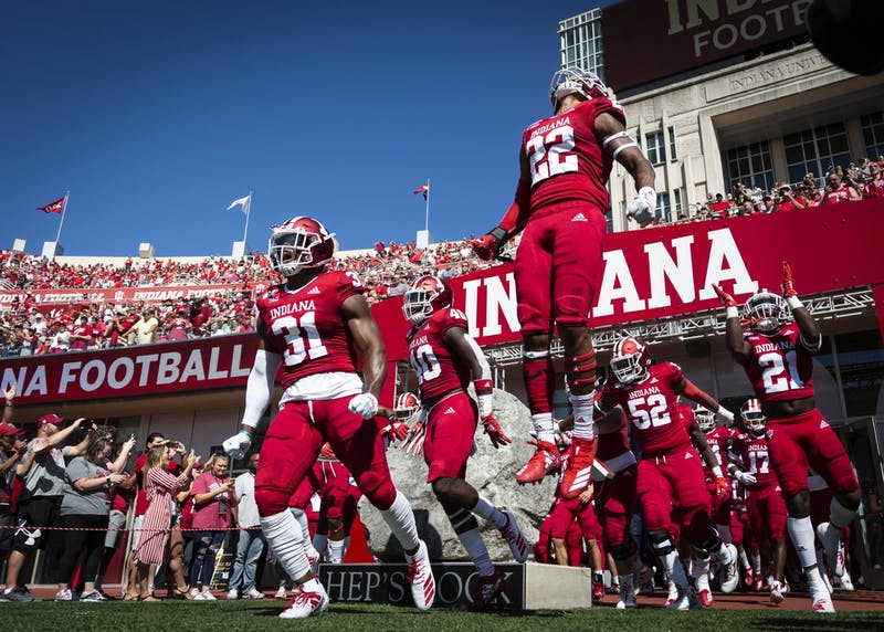 IU football players take the field at the start of the game against Ohio State on Sept. 14, 2019, at Memorial Stadium. IU will play a nine-game football schedule this season starting Oct. 24 against Penn State.