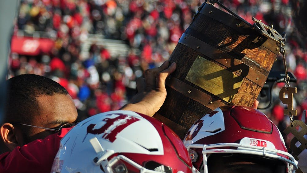 IU holds up the Old Oaken Bucket trophy after their 26-24 win over Purdue on Nov. 26, 2016 at Memorial Stadium.