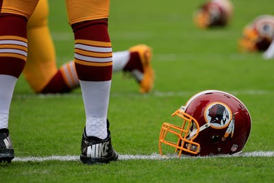 A Washington Redskins helmet is seen in 2014 on the field before a game.
