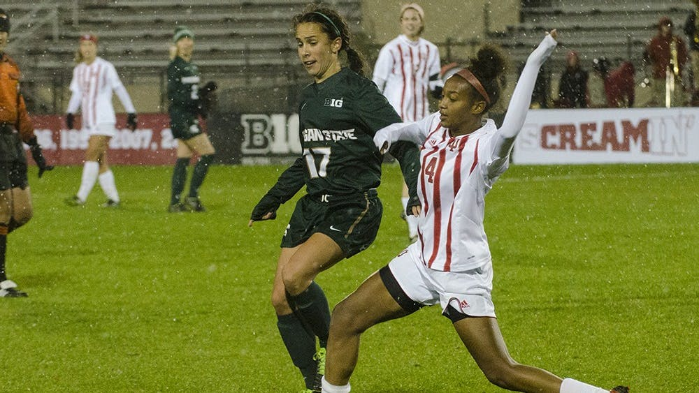 Freshman defender Mykayla Brown breaks up a pass intended for Michigan State midfielder Sarah Kovan during the Hoosier's final game of the season friday night. IU won 2-0 and finsihed its season 7-11-1.