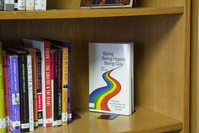 Many books line the shelves at the LGBTQ+ Culture Center library. The LGBTQ+ Center started a mentoring program in 2018 as a way for LGBTQ students at IU to help incoming LGBTQ freshmen navigate their first semester of school.