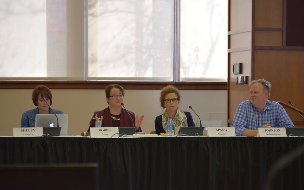 Provost Lauren Robel discusses the Officer's Report with the other BFC members.
