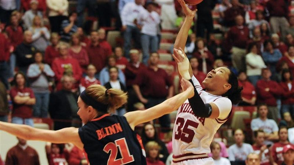 Illinois guard Macie Blinn fouls IU guard Kim Roberson during the second half of IU's 66-59 loss Feb. 8 at Assembly Hall. Roberson had 11 points and nine rebounds.
