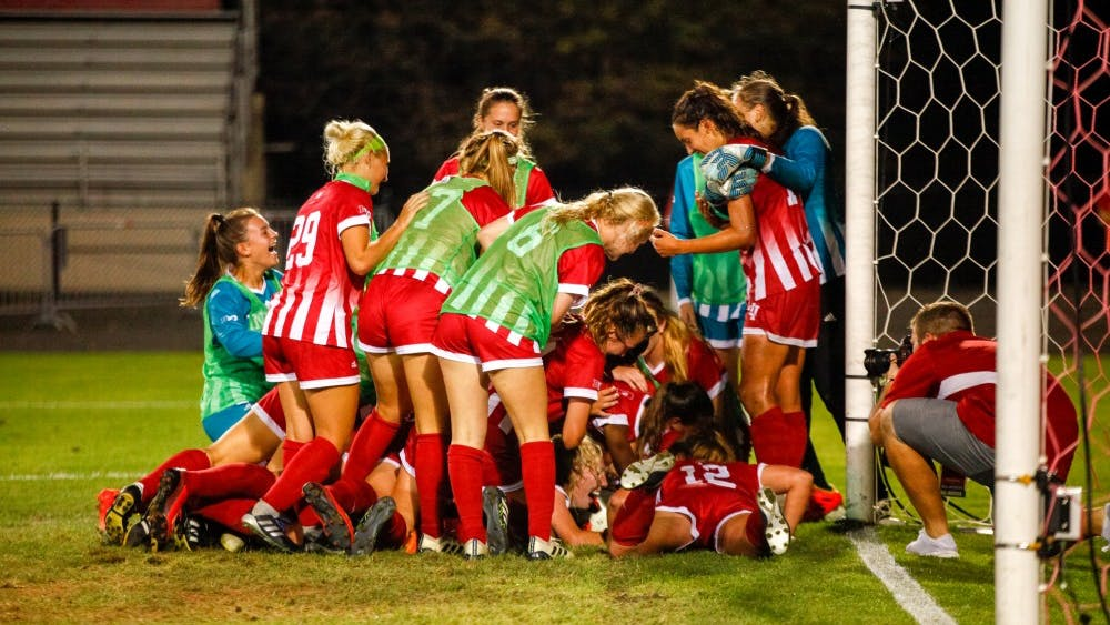 IU storms the field and celebrates their victory Sept. 13 at Bill Armstrong Stadium. IU beat Michigan in overtime, 3-2.