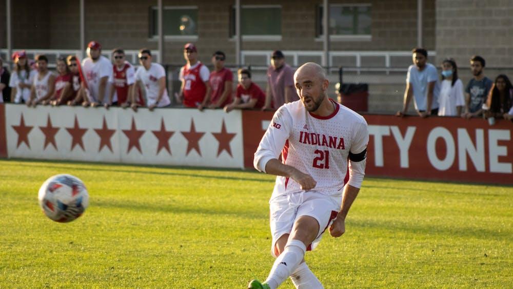Senior defender Spencer Glass passes the ball Oct. 1, 2021. Glass assisted on junior forward Victor Bezerra's golden goal against the University of Nebraska Omaha.