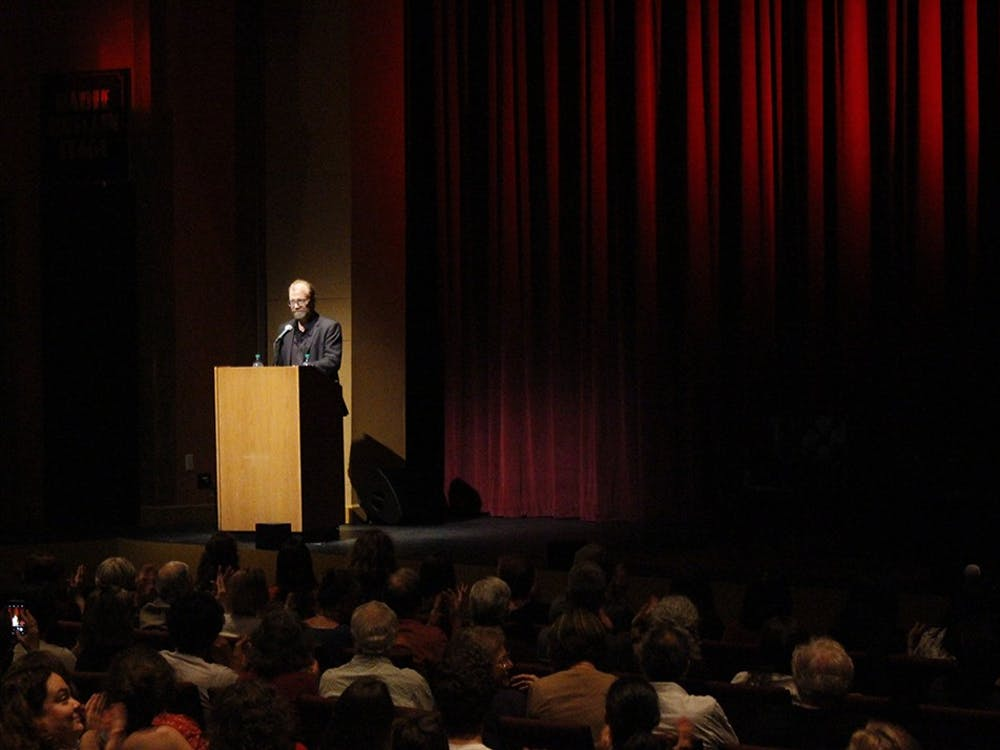 """Author George Saunders speaks to a crowd of students and faculty Tuesday at the Buskirk-Chumley Theater. Saunders read from his recently published novel, """"Lincoln in the Bardo,"""" answered questions from the audience and signed books after the talk."""