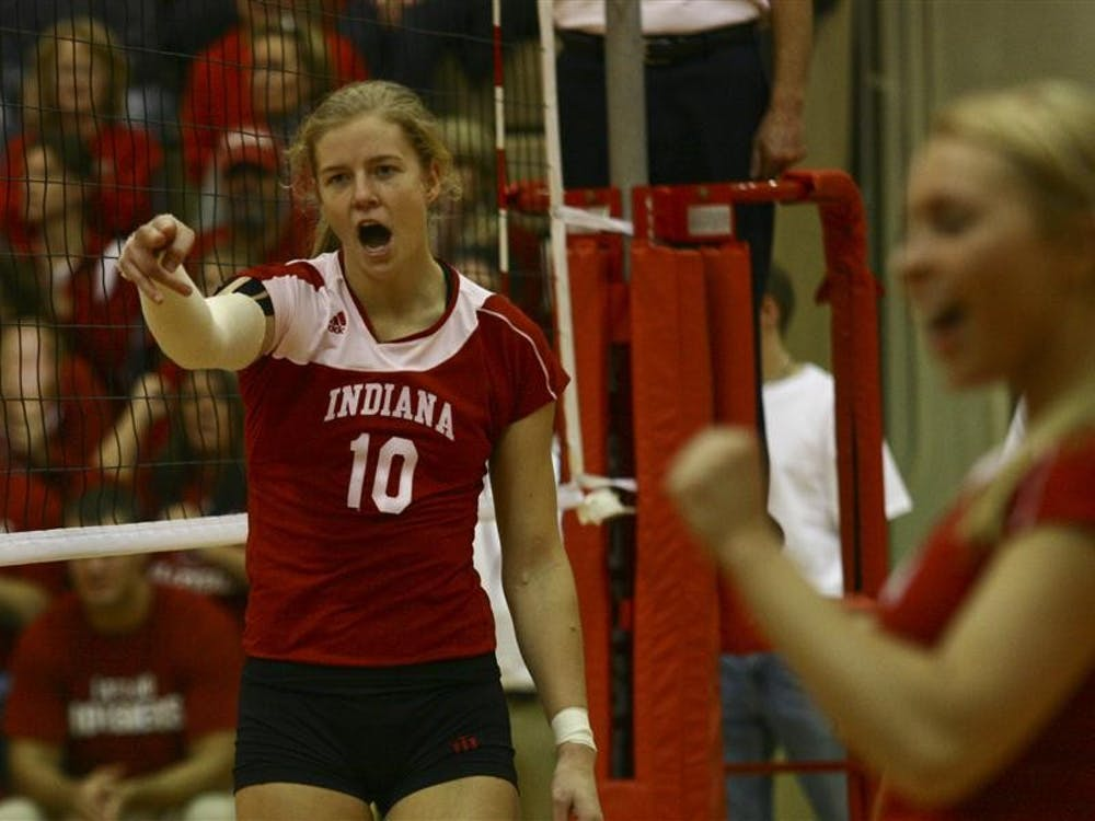 Senior Ashley Benson cheers on a teammate after a point against the Lady Volunteers on Saturday in University Gym.