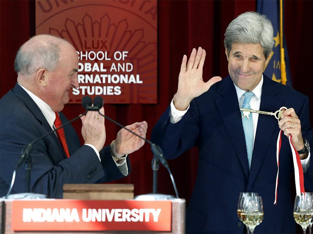 Secretary of State John Kerry shows the Global and International Studies Building key, given by the President of IU Michael A. McRobbie, left, to audiences inside of the same building on Thursday, Oct. 15.